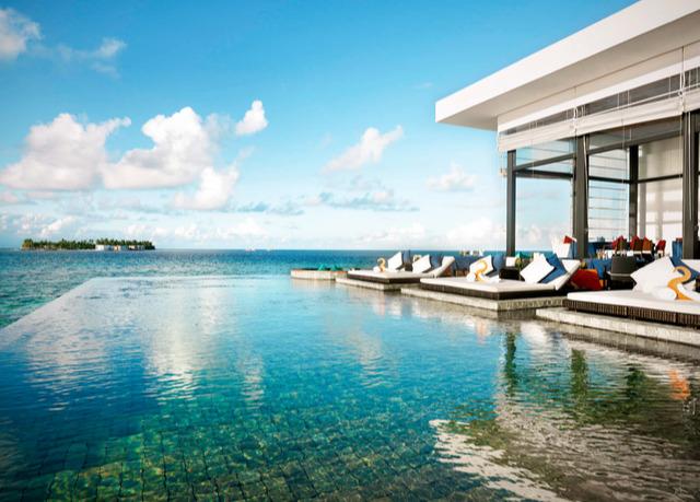 beach villa mit eigenem pool im 5 sterne dhevanafushi. Black Bedroom Furniture Sets. Home Design Ideas